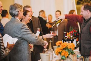 Guests sampling wine at the Chapman Museum's annual Wine and Chocolate fundraiser