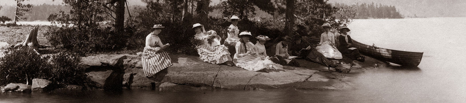 Women in hats on the shores of a lake in the Adirondacks