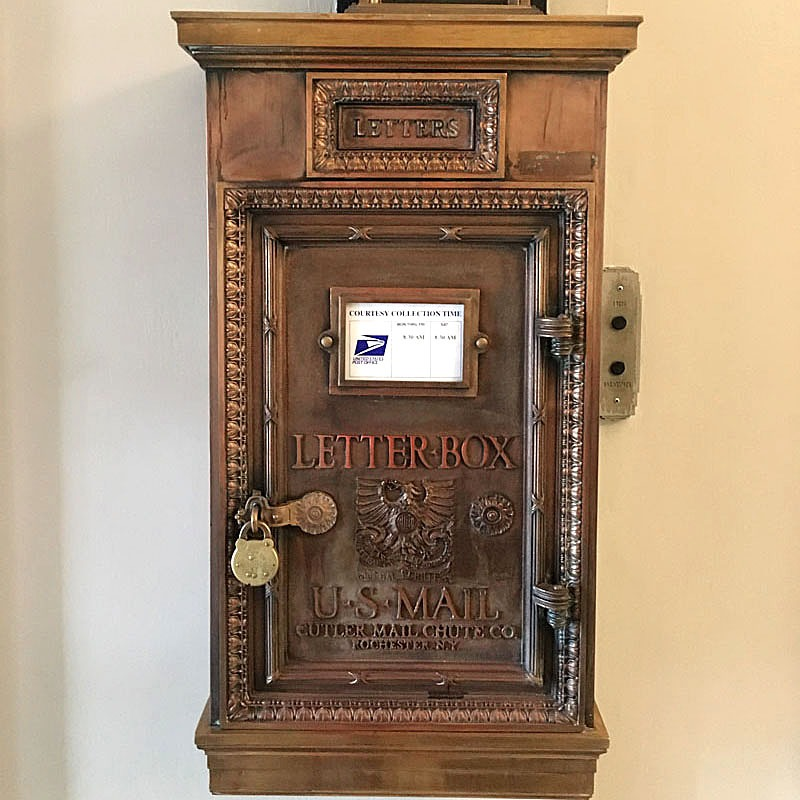 "A cast metal mailbox that bears the raised lettering that states ""Letter Box"" and an embossed eagle design, beneath which is the company stamp Cutler Mail Chute Company, Rochester, NY."