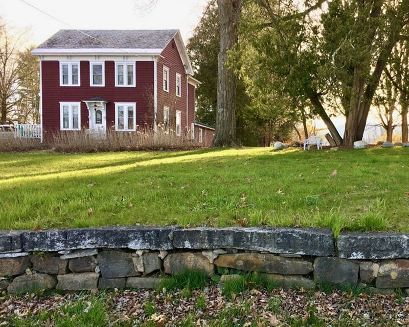 stone wall with red tenant house
