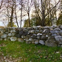 stone wall in lawn