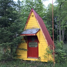 yellow A-frame shed