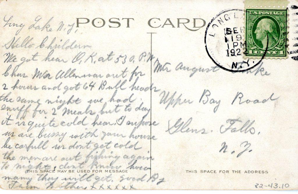 handwritten letter on back of postcard