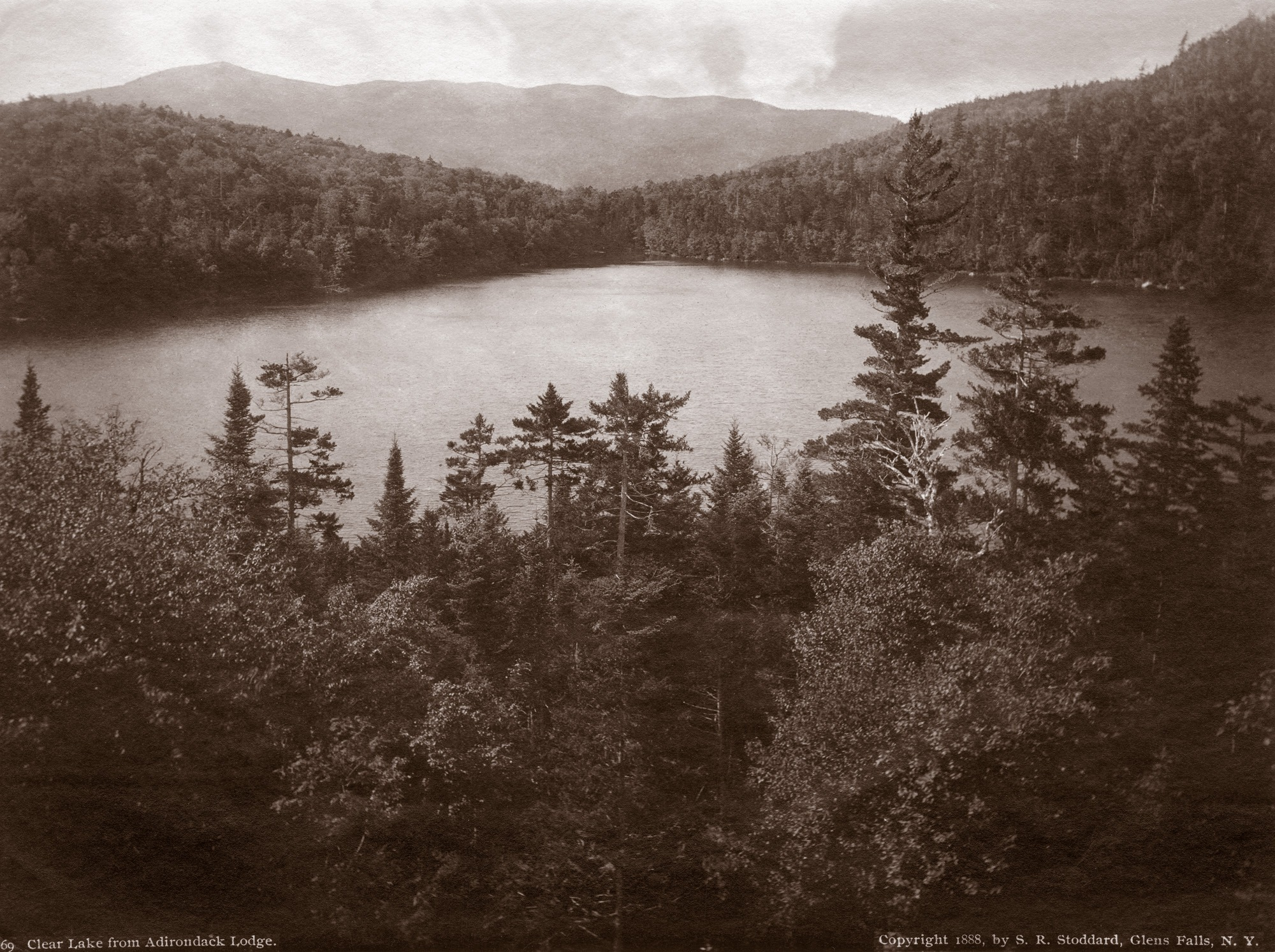 view of mountains from across a small lake