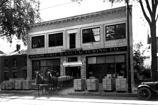 old photo of store front with a horse team