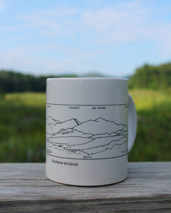 white mug with skecth of mountains