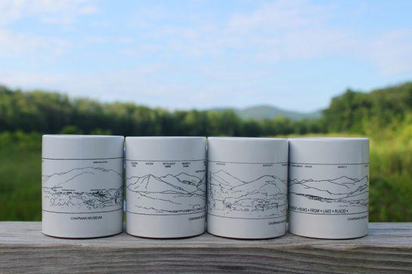 4 white mugs against a blue sky