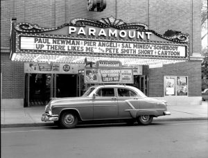 1950s car in front of a movie theater